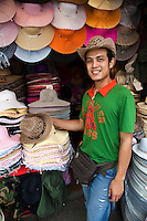 Hatter at Chatuchak Market - Chatuchak Market or sometimes called the Weekend Market is the largest market in Thailand, and one of the largest in the world covering over 35 acres with more than 5,000 stalls not counting wandering vendors and street entertainers. It is estimated that the market receives between 200,000 and 300,000 visitors each day on Saturdays and Sundays. The market offers a wide variety of products including household items, hats, clothing, Thai crafts, religious artifacts, collectibles, foods, and even live animals.