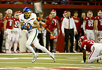 VERMILLION, SD - NOVEMBER 18: Jake Wieneke #19 from South Dakota State University spins out of the tackle of Phillip Powell #21 from the University of South Dakota for a 69 yard touchdown during their game Saturday afternoon at the DakotaDome in Vermillion. (Photo by Dave Eggen/Inertia)