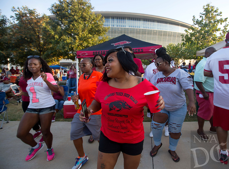 NWA Democrat-Gazette/JASON IVESTER<br /> Kimberly Bobo of Fort Worth, Texas, dances with friends on Saturday, Sept. 24, 2016, at AT&amp;T Stadium in Arlington, Texas, before the game against Texas A&amp;M.