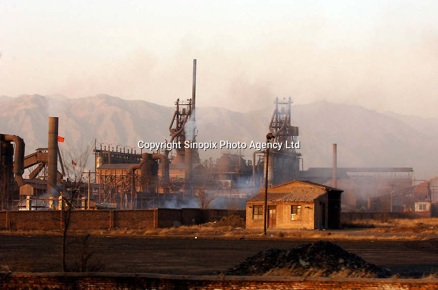A petrol chemical plant near Datong, Shanxi province, China. Datong is an old coal mining city resembles those of the industrial revolution in the early 20th century with people living in tiny brick houses in very basic conditions. China's economic miracle is just a dream for these people..26 Nov 2006