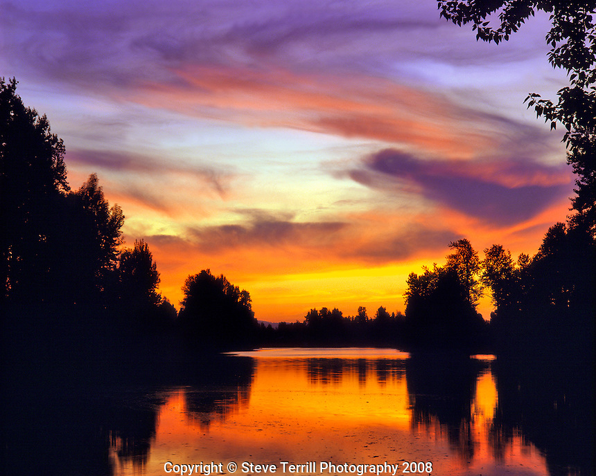 Sunset reflecting in Columbia Slough in Multnomah County Oregon