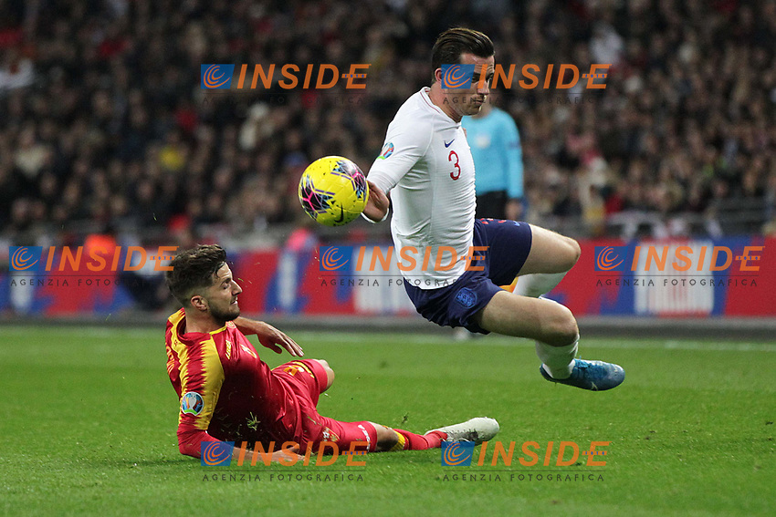 Ben Chilwell of England is tackled by Deni Hocko of Montenegro during the UEFA Euro 2020 Qualifying Group A match between England and Montenegro at Wembley Stadium on November 14th 2019 in London, England. (Photo by Matt Bradshaw/phcimages.com)<br /> Foto PHC Images / Insidefoto <br /> ITALY ONLY