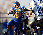 BROOKINGS, SD - NOVEMBER 9:  Zach Zenner #31 from South Dakota State University scampers past Connor Underwood #55 and Mark Sewall #21 from Indiana State University Saturday at Coughlin Alumni Stadium. (Photo by Dave Eggen/Inertia)