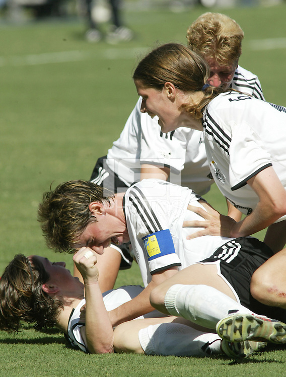 Germany celebrates after scoring first goal, Germany vs. Sweden in Carson, California on October 12th, 2003.  Germany won 2-1 against Sweden in overtime.