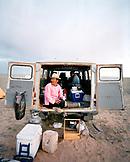 MONGOLIA, Nemegt Basin, camel guide Jamiyan camping in the Gobi desert