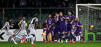 Calcio, ritorno degli ottavi di finale di Europa League: Fiorentina vs Juventus. Firenze, stadio Artemio Franchi, 20 marzo 2014. <br /> Juventus midfielder Andrea Pirlo, left, scores the winning goal on a free kick during the Europa League round of 16 second leg football match between Fiorentina and Juventus at Florence's Artemio Franchi stadium, 20 March 2014. Juventus won 1-0 to advance to the quarter-finals.<br /> UPDATE IMAGES PRESS/Isabella Bonotto