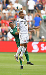 Lester Peltier (18) of Trinidad and Tobago and Ronayne Marsh-Brown (6) of Guyana vie for a header during their Gold Cup match on June 26, 2019 at Children's Mercy Park in Kansas City, KS.<br /> Tim VIZER/AFP