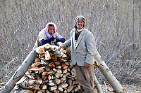 Portrait of farmers  preparing firewood