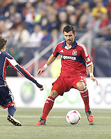 Chicago Fire defender Gonzalo Segares (13) controls the ball. In a Major League Soccer (MLS) match, the New England Revolution (blue) defeated Chicago Fire (red), 1-0, at Gillette Stadium on October 20, 2012.