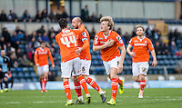 Cameron McGeehan (8) of Luton Town celebrates scoring his winning goal during the Sky Bet League 2 match between Wycombe Wanderers and Luton Town at Adams Park, High Wycombe, England on 6 February 2016. Photo by Andy Rowland.