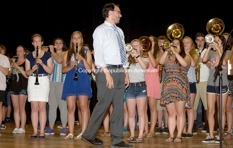 WINSTED CT. 17 June 2014-061714SV01-Scott Minnerly, band director, gets a welcome from the band after being named Gilbert School teacher of the year during an assembly at the school in Winsted Tuesday. <br /> Steven Valenti Republican-American