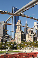 The Chicago skyline as seen through the expansive trellis arching out from the Jay Pritzker Pavillion, one of architect Frank Gehry's career masterworks, situated within Millenium Park.