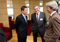 L-R: Vice Mayor of Shanghai Tu Guangshao, GDF Suez CEO and Paris Europlace Chairman Gerard Mestrallet, French Consul General in Shanghai Emmanuel Le Nain, chat at Shanghai / Paris Europlace Financial Forum, in Shanghai, China, on December 1, 2010. Photo by Lucas Schifres/Pictobank