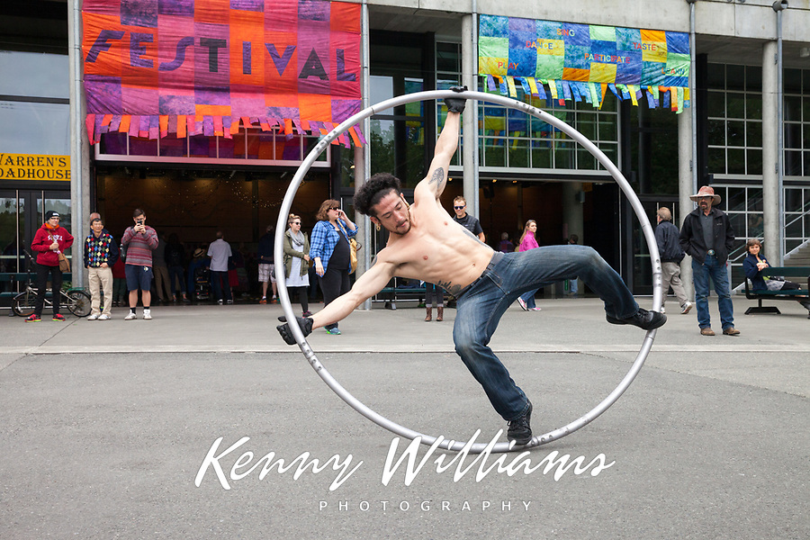 Cyr Wheel Street Performer, Northwest Folklife Festival 2015, Seattle Center, Washington, USA.