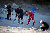 FAO JANET TOMLINSON, DAILY MAIL PICTURE DESK<br /> Pictured: Special forensics police officers and a Red Cross volunteer search a field in Kos, Greece. Monday 03 October 2016<br /> Re: Police teams led by South Yorkshire Police, searching for missing toddler Ben Needham on the Greek island of Kos have moved to a new area in the field they are searching.<br /> Ben, from Sheffield, was 21 months old when he disappeared on 24 July 1991 during a family holiday.<br /> Digging has begun at a new site after a fresh line of inquiry suggested he could have been crushed by a digger.