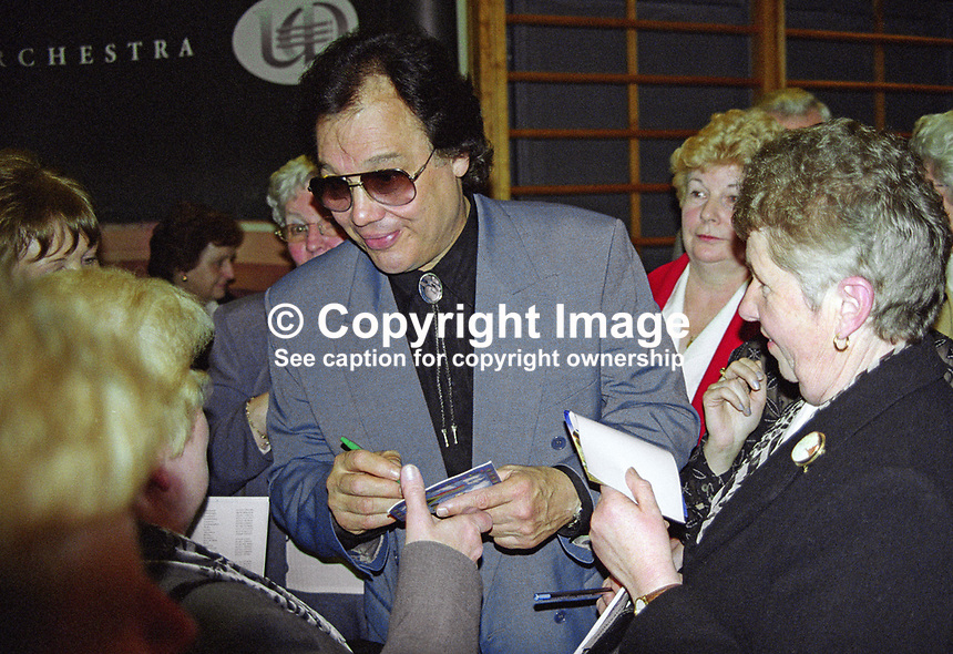 Roly Daniels, born India, grew up in Ireland, country and western singer, signing autographs at Waterfront Hall, Belfast, N Ireland, following &quot;Do you come here often?&quot; concert. 2000125001.<br />