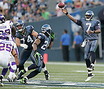 Seattle Seahawks quarterback Tavaris Jackson unleashes a pass to running back Marshawn Lynch against the Minnesota Vikings at CenturyLink Field in Seattle, Washington August 20, 2011. The Vikings beat the Seahawks  20-7. ©2011 Jim Bryant Photo. All Rights Reserved.
