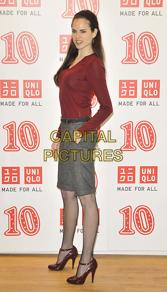 Amy Bailey.The Uniqlo 10th anniversary party, Uniqlo, Regent St., London, England..October 12th, 2011.full length red long sleeves top hand in pocket grey gray shorts t-bar shoes side.CAP/CAN.©Can Nguyen/Capital Pictures.