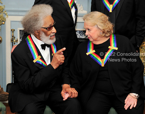 Sonny Rollins, left, and Barbara Cook, right, two of the five recipients of the 2011 Kennedy Center Honors, share some thoughts as they wait to pose for a photo following a dinner hosted by United States Secretary of State Hillary Rodham Clinton at the U.S. Department of State in Washington, D.C. on Saturday, December 3, 2011. The 2011 honorees are actress Meryl Streep, singer Neil Diamond, actress Barbara Cook, musician Yo-Yo Ma, and musician Sonny Rollins..Credit: Ron Sachs / CNP