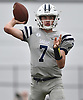 Charlie McKee #7, Oceanside freshman quarterback, throws a pass during a Nassau County Conference I varsity football game against host Baldwin High School on Saturday, Oct. 6, 2018. Oceanside won by a score of 35-0.