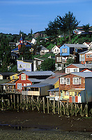 PALAFITOS (shingled houses on stilts) extend into a lagoon and are the homes of CASTRO fisherman - CHILOE ISLAND, CHILE