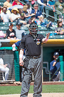 Home plate umpire Ryan Blakney in action as  the Salt Lake Bees played the Reno Aces in Pacific Coast League action at Smith's Ballpark on May 10, 2015 in Salt Lake City, Utah.  Salt Lake defeated Reno 9-2 in Game One of the double-header. (Stephen Smith/Four Seam Images)