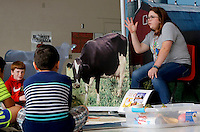 NWA Democrat-Gazette/DAVID GOTTSCHALK Katie Stewart, an intern at Harp Elementary School, discusses the Arkansas Plate Farm with students Friday, September 11, 2015 as they participate in the Farm and You agricultural program at the school in Springdale. Students at the school rotated through nine stations with different interactive activities about the importance of food, farms and good health.