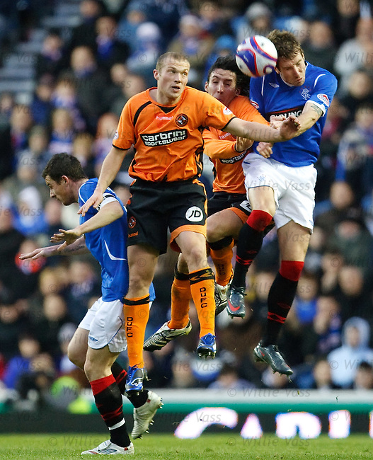 Kirk Broadfoot knocks the ball clear from Francisco Sandaza and Warren Feeney