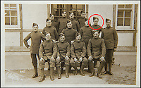 BNPS.co.uk (01202 558833)<br /> Pic: C&amp;TAuctions/BNPS<br /> <br /> CPL Albert Mayo who served in the Royal Flying Corps during the First World War (second row second from right).<br /> <br /> A poignant time capsule containing the last belongings of a tragic airman his grief-stricken parents couldn't bring themselves to look at has been discovered during a house clearance.<br /> <br /> The poignant archive of letters, logbooks, diary, photos and medals relating to Flight Sergeant Norman Mayo were placed in a small suitcase in 1945 by Albert and Annie Mayo and seemingly never opened again.<br /> <br /> The black leather case was found stashed under a bed by a house clearance firm tasked with getting rid of the contents before the empty property in Finchley, North London.<br /> <br /> The archive is now being sold by C&amp;T Auctioneers.