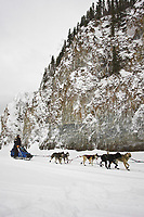 Rick Casillo runs past the rock cliffs on the Yukon River at Ruby on Saturday morning during Iditarod 2008