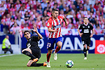 Jose Angel Cote of SD Eibar (R) trips up with Victor Vitolo of Atletico de Madrid (L) during the La Liga match between Atletico Madrid and Eibar at Wanda Metropolitano Stadium on May 20, 2018 in Madrid, Spain. Photo by Diego Souto / Power Sport Images