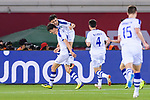 Eldor Shomurodov of Uzbekistan (L) celebrates scoring with teammates during the AFC Asian Cup UAE 2019 Group F match between Japan (JPN) and Uzbekistan (UZB) at Khalifa Bin Zayed Stadium on 17 January 2019 in Al Ain, United Arab Emirates. Photo by Marcio Rodrigo Machado / Power Sport Images