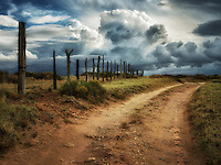 Road, fenceline and thunderstorm near Coal Mine Canyon, Arizona