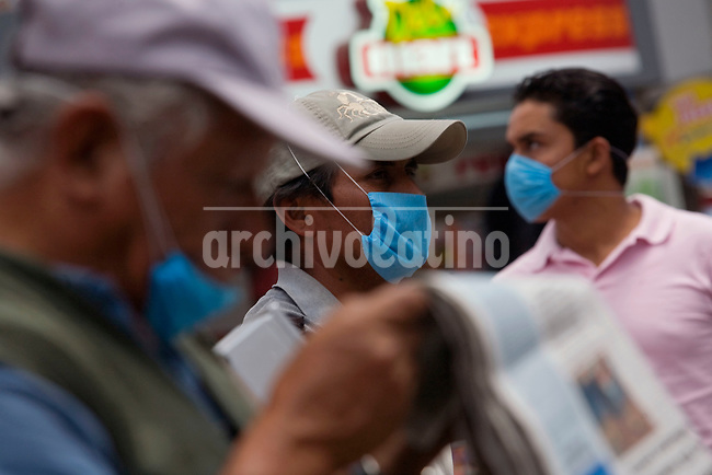 Authorities in Mexico DF distributed  protective masks to prevent swine flu, an epidemic spreading fast through the country.
