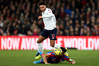 23rd November 2019; Selhurst Park, London, England; English Premier League Football, Crystal Palace versus Liverpool; Alex Oxlade-Chamberlain of Liverpool competes for the ball with Andros Townsend of Crystal Palace - Strictly Editorial Use Only. No use with unauthorized audio, video, data, fixture lists, club/league logos or 'live' services. Online in-match use limited to 120 images, no video emulation. No use in betting, games or single club/league/player publications