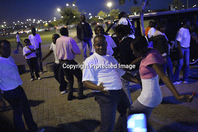 Youth dance to loud music in the streets of Soweto.