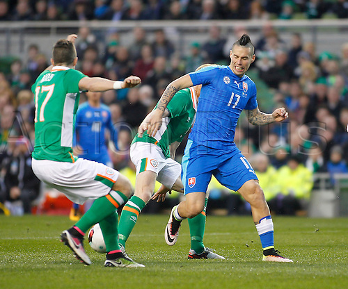 29.03.2016. Aviva Stadium, Dublin, Ireland.  International Football Friendly Ireland versus Slovakia. Paul McShane and Stephen Ward (Rep. of Ireland) block Marek Hamsik's (Slovakia) advances.