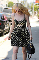 Dakota Fanning looked great in a swan print and cut out dress while on a pizza run in Beverly Hills. Los Angeles, California on 20.06.2012.Credit: Vida/face to face /MediaPunch Inc. ***Online Only for USA Weekly Print Magazines*** NORTEPOTO.COM<br />