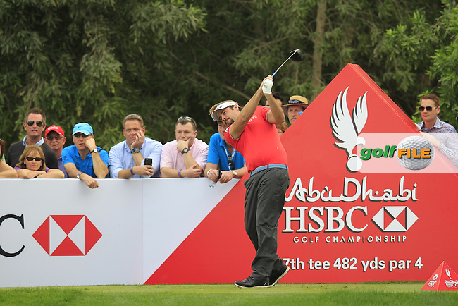 Victor Dubuisson (FRA) tees off the 17th tee during Sunday's Final Round of the Abu Dhabi HSBC Golf Championship 2015 held at the Abu Dhabi Golf Course, United Arab Emirates. 18th January 2015.<br /> Picture: Eoin Clarke www.golffile.ie