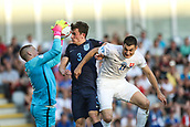 June 19th 2017, Kielce, Poland; UEFA European U-21 football championships, England versus Slovakia; Matus Bero (SLO) challenges as goalkeeper Jordan Pickford (ENG) saves assisted by Ben Chilwell (ENG)