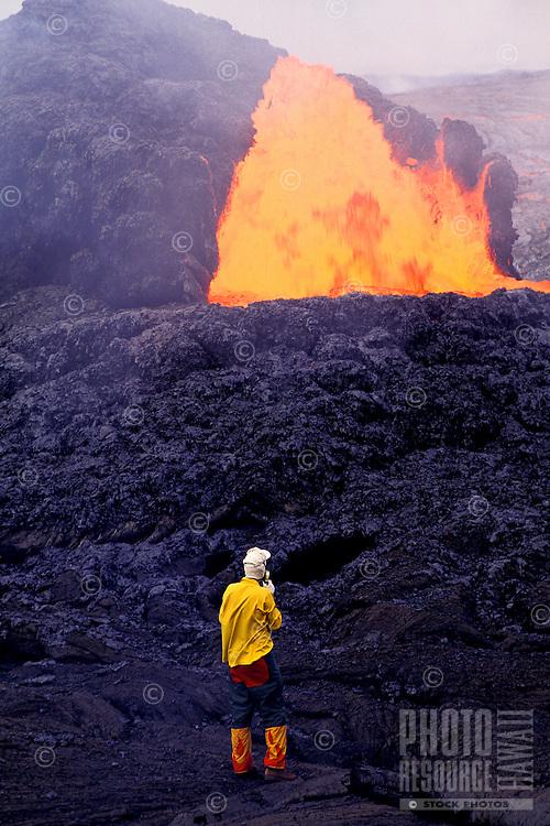 Scientist near fountaining eruption at Kilauea volcano, Hawaii Volcanoes National Park