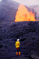 Scientist near fountaining eruption at Kilauea volcano, Hawaii Volcanoes National Park
