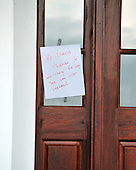 Note on the front door of the house in Front Royal, Virginia  that is registered to Tareq and Michaele Salahi..Credit: Ron Sachs / CNP.(RESTRICTION: NO New York or New Jersey Newspapers or newspapers within a 75 mile radius of New York City)