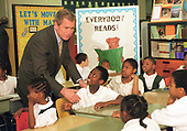 United States President George W. Bush greets third graders at Merritt Elementary School in Washington, D.C. on January 25, 2001. President Bush was trying to focus attention on his education agenda calling for greater accountability from the schools and teachers.<br /> Credit: Robert Trippett - Pool / CNP