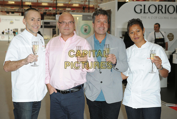 MICHEL ROUX JR., GREGG WALLACE, JOHN TORODE & MONICA GALETTI.at the Masterchef Live Exhibtion, Olympia, London, England, UK, .November 12th 2010..full length pink shirt blue grey gray jacket champagne glass drink  trousers blue black chefs chef white whites .CAP/WIZ.© Wizard/Capital Pictures.