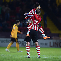 Lincoln City's Matt Green, left celebrates scoring the opening goal with team-mate Matt Rhead<br /> <br /> Photographer Andrew Vaughan/CameraSport<br /> <br /> The EFL Checkatrade Trophy Northern Group H - Lincoln City v Wolverhampton Wanderers U21 - Tuesday 6th November 2018 - Sincil Bank - Lincoln<br />  <br /> World Copyright © 2018 CameraSport. All rights reserved. 43 Linden Ave. Countesthorpe. Leicester. England. LE8 5PG - Tel: +44 (0) 116 277 4147 - admin@camerasport.com - www.camerasport.com