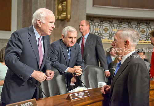 """United States Secretary of Defense James N. Mattis, right, speaks with United States Senator John McCain (Republican of Arizona), Chairman, US Senate Committee on Armed Services, left, and US Senator Jack Reed (Democrat of Rhode Island), Ranking Member, US Senate Committee on Armed Services, center, prior to giving testimony before the committee on """"the Department of Defense budget posture in review of the Defense Authorization Request for Fiscal Year 2018 and the Future Years Defense Program"""" on Capitol Hill in Washington, DC on Tuesday, June 13, 2017.<br /> Credit: Ron Sachs / CNP"""