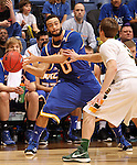 SIOUX FALLS, SD - MARCH 10:   Nate Rogers #0 from UMKC looks to get a pass around Mike Felt #3 from North Dakota State University in the second half of their semifinal game Sunday evening at the 2013 Summit League Basketball Tournament in Sioux Falls. SD. (Photo by Dave Eggen/Inertia)