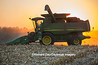 63801-06718 John Deere combine harvesting corn at sunset, Marion Co., IL