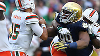 Miami Hurricanes quarterback Brad Kaaya (15) is pressured by Notre Dame Fighting Irish defensive lineman Jerry Tillery (99) in the third quarter.